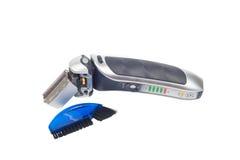 Máquina de afeitar eléctrica negra para hombre con la escobilla Imagenes de archivo