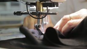 Máquina de coser almacen de video