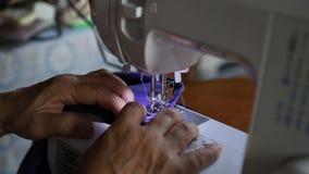 Máquina de costura video estoque