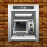 Máquina de dinheiro do banco do ATM em um fundo da parede de tijolo Foto de Stock Royalty Free