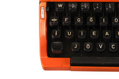 A máquina de escrever alaranjada do vintage no fundo branco Imagem de Stock