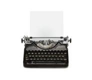 Máquina de escrever retro com folha de papel Fotos de Stock