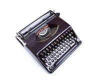 Máquina de escrever velha de Brown isolada Fotografia de Stock Royalty Free