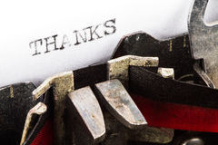 Máquina de escribir con gracias del texto Foto de archivo libre de regalías