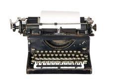 Máquina de escribir de la vendimia en el fondo blanco Foto de archivo libre de regalías