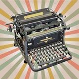 Máquina de escribir del viejo estilo en fondo retro Foto de archivo libre de regalías
