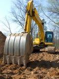 Máquina de la construcción de la azada de la pista fotografía de archivo
