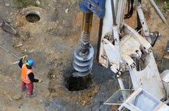 Máquina de perfuração hidráulica do martelo no canteiro de obras Fotos de Stock Royalty Free