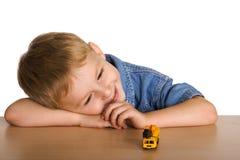 Máquina de sorriso da criança e do brinquedo Fotos de Stock Royalty Free