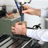 Máquina de trituração do trabalho Imagens de Stock