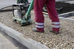 Máquina de vibração para reparar o asfalto Fotografia de Stock Royalty Free