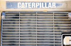 Máquina del amarillo del dormilón de la niveladora de Caterpillar parqueada Imagenes de archivo