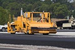 Máquina del asfalto imagen de archivo