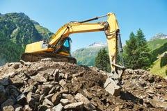 Máquina del cargador de excavador en el emplazamiento de la obra Foto de archivo