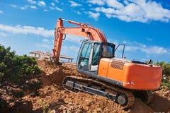 Máquina del cargador de excavador en el emplazamiento de la obra Fotografía de archivo