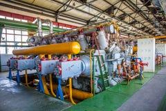 Máquina del compresor y del colector en fábrica Imagen de archivo libre de regalías