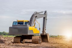 Máquina del excavador de las retroexcavadoras en un emplazamiento de la obra foto de archivo