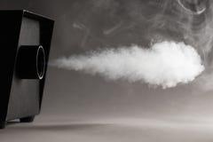 Máquina del humo en la acción Imagen de archivo libre de regalías