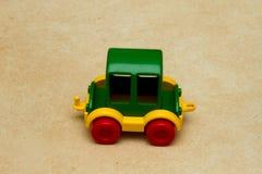 Máquina del ` s de los niños en el piso Imágenes de archivo libres de regalías