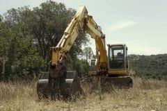 Máquina escavadora abandonada Fotos de Stock Royalty Free