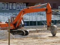 Máquina escavadora alaranjada Fotografia de Stock