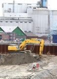 Máquina escavadora amarela Foto de Stock Royalty Free