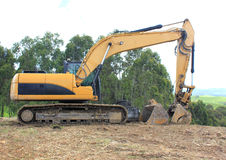 Máquina escavadora amarela Fotos de Stock