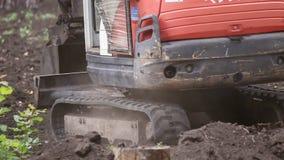 Máquina escavadora com passeios da cubeta vídeos de arquivo