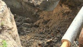 Máquina escavadora da cubeta filme