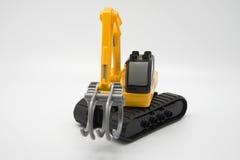 Máquina escavadora do brinquedo Fotos de Stock