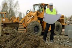 Máquina escavadora e arquiteto. Imagens de Stock Royalty Free