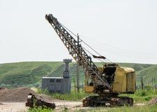 Máquina escavadora em uma pedreira Fotografia de Stock Royalty Free
