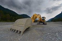 Máquina escavadora mecânica alaranjada da pá Fotografia de Stock Royalty Free