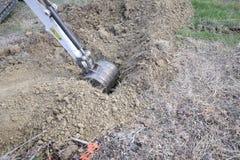 Máquina escavadora no trabalho Imagens de Stock