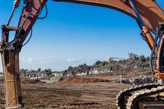 A máquina escavadora nos meus Foto de Stock