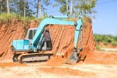Máquina escavadora seguida Imagem de Stock