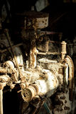 Máquina oxidada en putrefacto viejo Fotografía de archivo libre de regalías