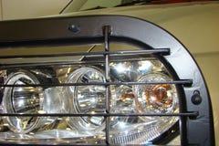 Máquina superior e mais baixa das luzes dianteiras Foto de Stock Royalty Free