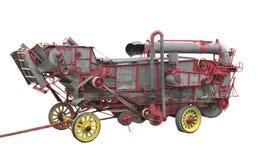Máquina trilladoa vieja aislada Imagen de archivo libre de regalías