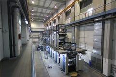 Máquina y almacén de la impresión en offset fotos de archivo libres de regalías