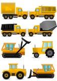 máquinas amarelas ajustadas da construção Fotografia de Stock Royalty Free
