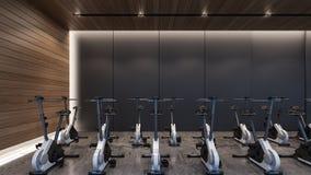 Máquinas do ciclismo na rendição gym/3D foto de stock royalty free