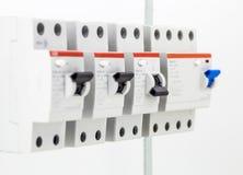 máquinas elétricas, interruptores, no fundo branco, close up Imagens de Stock Royalty Free