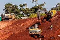 Máquinas escavadoras da engenharia civil das terraplenagens Imagens de Stock Royalty Free