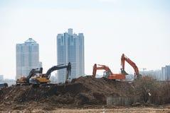 Máquinas escavadoras de trabalho Fotos de Stock