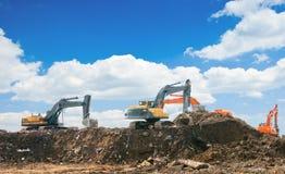 Máquinas escavadoras de trabalho Imagem de Stock Royalty Free