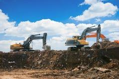 Máquinas escavadoras de trabalho Imagens de Stock