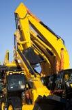 Máquinas escavadoras novas em uma fileira Imagens de Stock Royalty Free