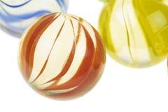 Mármores de vidro coloridos, tiro macro imagens de stock