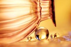 Mármores dourados e um vidro Foto de Stock Royalty Free